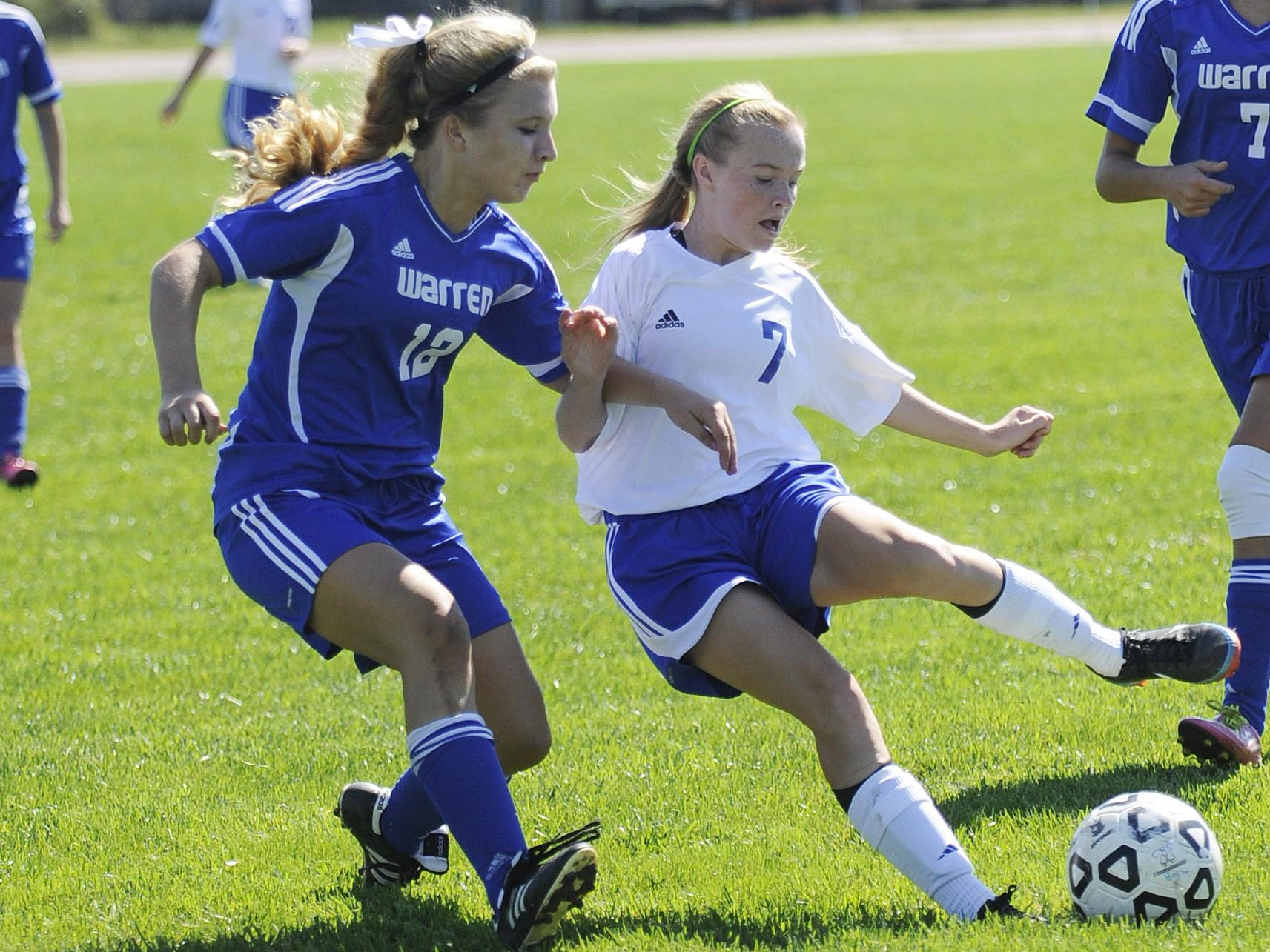 Chillicothe's Payten Davis tries to get around Warren's Emma Yabs during a 2013 game at McVicker Field. Davis, now a junior, will come into the 2015 season with 50 career goals.