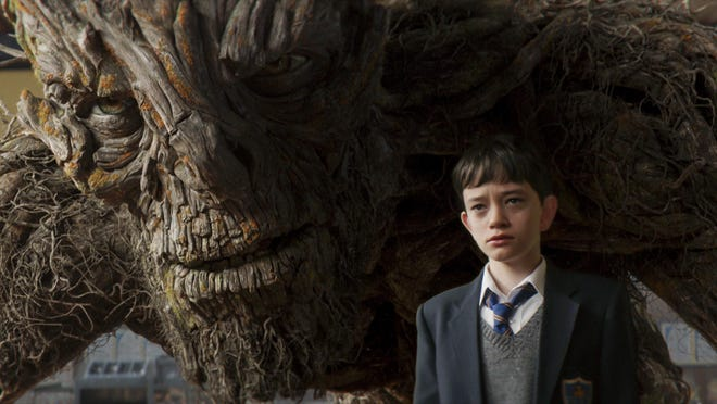 "The Monster (Liam Neeson) and Lewis MacDougall in ""A Monster Calls."""
