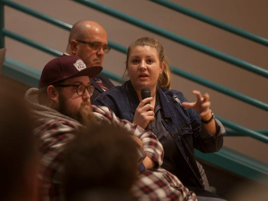 Bailey Zimmerman, DSU Vice President of Student Life, responds to comments and questions from attendees at the truth in tuition meeting concerning the allocation of student fees Tuesday, March 6, 2018.