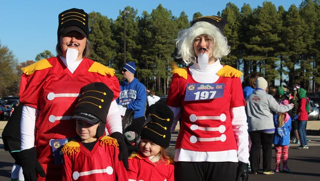The Kenyon family (from left), Rowynn, 3, Mitzi (Mae Mae), Knox, 6, and Dana (mom), were the only Nutcrackers participating in the Run Run Rudolph 5K event.