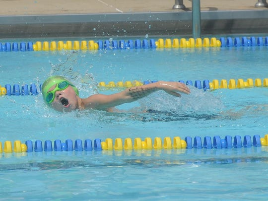 Mountain Home's Isaac Wiggins competes in the 8-and-under boys' 50-meter freestyle event on Saturday at Cooper Park.