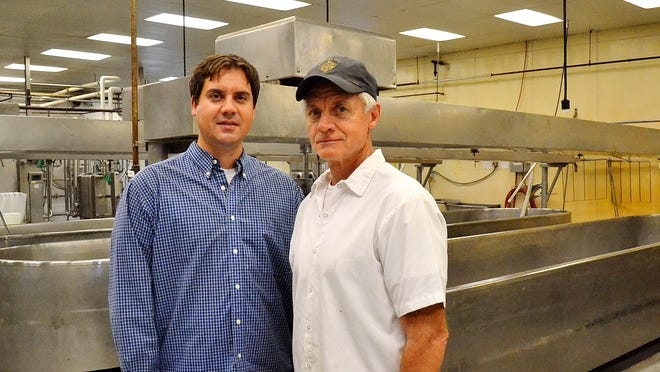 Nathan Hintz and his father Wayne Hintz are seen inside the production room at Springside Cheese Corporation north of Oconto Falls. Wayne last month transferred most of the ownership to sons Nathan, who is vice president, and son Keith, who serves as president. Keith also operates a Springside retail store in Pueblo, Colo.