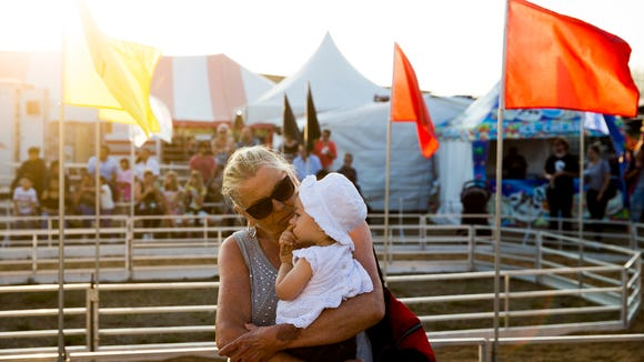 Bette Thomas, from the Twin Cities, Minnesota area, holds her granddaughter Aubrey, a Naples local, at the Collier County Fairgrounds Monday, March 19, 2018 in Naples.