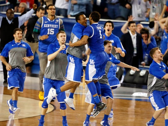 Apr 5, 2014; Arlington, TX, USA; The Kentucky Wildcats celebrate after beating the Wisconsin Badgers in the semifinals of the Final Four in the 2014 NCAA Mens Division I Championship tournament at AT&T Stadium. Mandatory Credit: Kevin Jairaj-USA TODAY Sports