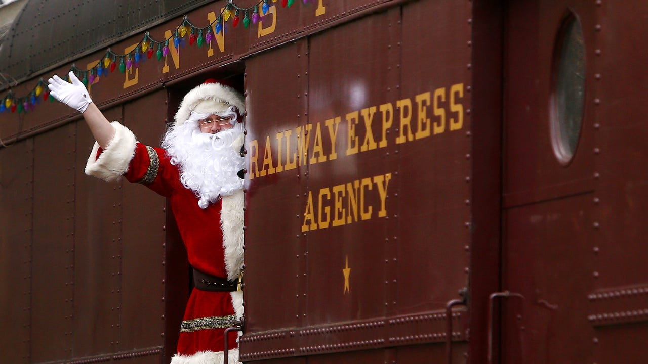 Santa and Marines travel by train to collect Christmas gifts in Morris County towns for needy children