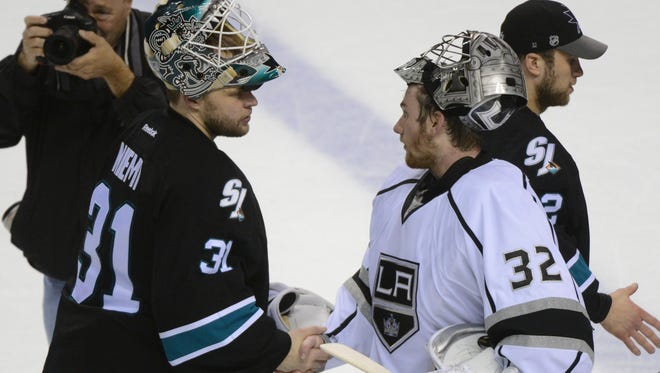 San Jose Sharks goalie Antti Niemi (31) congratulates Los Angeles Kings goalie Jonathan Quick (32) after game seven of the first round of the 2014 Stanley Cup Playoffs at SAP Center at San Jose. The Kings defeated the Sharks 5-1.
