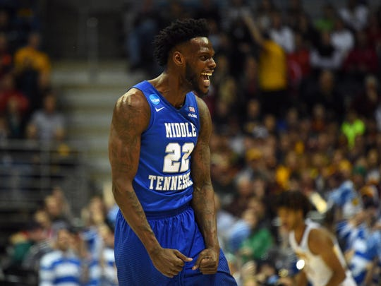 Mar 16, 2017; Milwaukee, WI, USA; Middle Tennessee Blue Raiders forward JaCorey Williams (22) celebrates during the second half of the game against the Minnesota Golden Gophers in the first round of the NCAA Tournament at BMO Harris Bradley Center. Mandatory Credit: James Lang-USA TODAY Sports