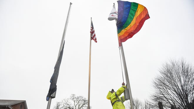 A Lebanon Valley College facilities services employee attaches a rainbow flag to the flag pole at the college on Monday, March 28, 2016, as LVC prepares to celebrate Freedom Week. 'Freedom Week is a week to celebrate students who identify as LGBT+ and educate the campus regarding LGBT+ issues,' according to a news release. The week is sponsored by Freedom Rings, LVC's LGBT+ organization.