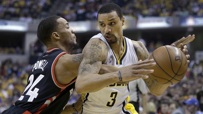Indiana Pacers guard George Hill (3) spins around Toronto Raptors guard Norman Powell (24)  in the first half of their Eastern Conference first round playoff game Saturday, April 23, 2016, afternoon at Bankers Life Fieldhouse.