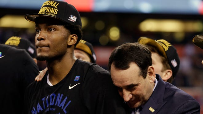 Duke coach Mike Krzyzewski, right, and Justise Winslow show their emotions over Jim Connell's win in the inaugural TRO bracket competition.