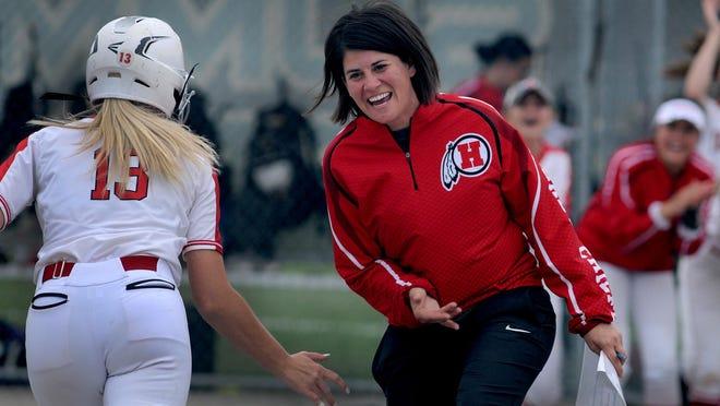 New Boston Huron softball coach Tedi Belisle congratulates Faith Callahan after a home run in the District finals last year.