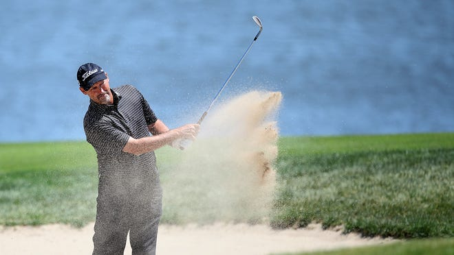 Stan Utley of Scottsdale, Ariz., knocks the ball out of a bunker at the Tournament Club of Iowa.