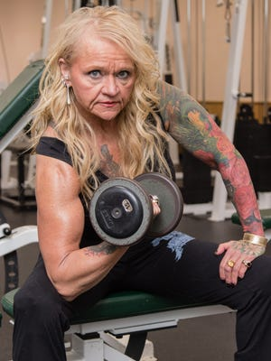 Liz Dudek, 59, owner of Stay Fit Gratiot County gym in Ithaca, holds the world record in the bench press for her age and weight class, lifting 165 pounds at the WPC World Championships last November in Baton Rouge, Louisiana.