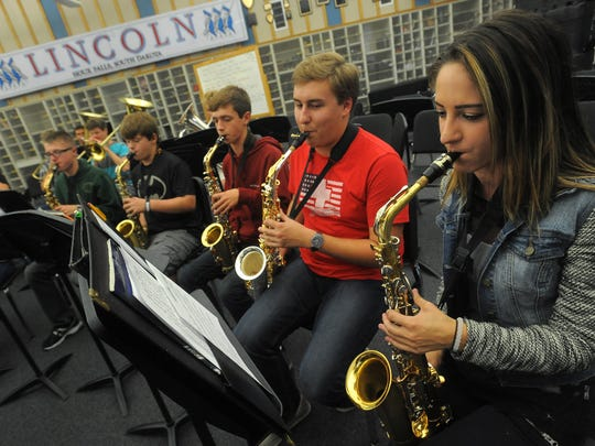Lincoln High School's Kate Layne (right) plays saxophones