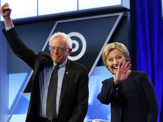 In this March 9, 2016, photo, Hillary Clinton and Bernie