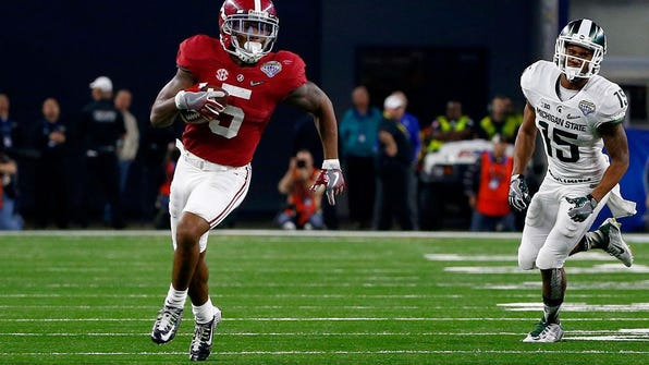 Alabama's Cyrus Jones returns a punt 57 yards for a touchdown against Michigan State in the national semifinal game last season.