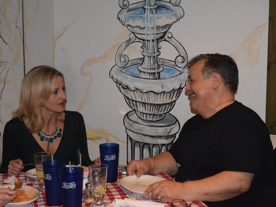 Owner Vinny Bellia chats with friend and former bartender Emilia Chrzaszcz during an appreciation party at the restaurant. Chrzaszcz worked at Vinnys La Roma for about 3 years, and she met her boyfriend, Market Street Inn owner Rob Mulford, during her time there.