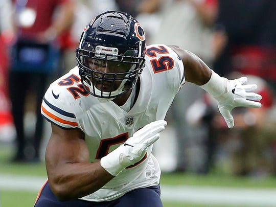 FILE - In this Sept. 23, 2018, file photo, Chicago Bears linebacker Khalil Mack (52) is shown in action in the first half during an NFL football game against the Arizona Cardinals, in Glendale, Ariz. Last week the Miami Dolphins tried assigning eight players to help with pass protection, and even that didn't prevent Ryan Tannehill from getting hit. And now the Dolphins have to block Khalil Mack. (AP Photo/Rick Scuteri, File)