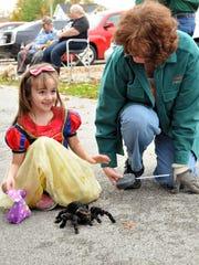 Mylin Ellis, 6, of Stony Ridge, smiles after petting