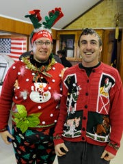 Kimberly Smith, of Lindsey, and Adam Miller, of Kansas, won the ugliest sweater contest after Gibsonburg's second annual Ugly Christmas Sweater Run on Saturday.