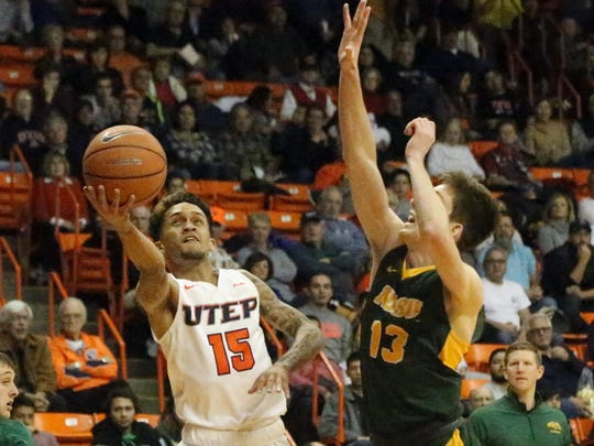UTEP's Kobe Magee, 15, drives for a layup but is rejected by Chris Quayle, 13, of NDSU Friday night.