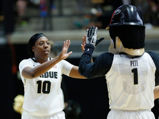Andreona Keys shares a high five with Purdue Pete after the Boilermakers defeated Illinois 64-51 Wednesday.