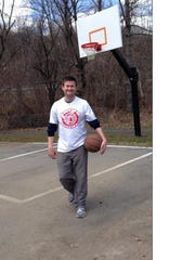 Pat Quinn just after his ALS diagnosis, playing basketball in Ardsley.