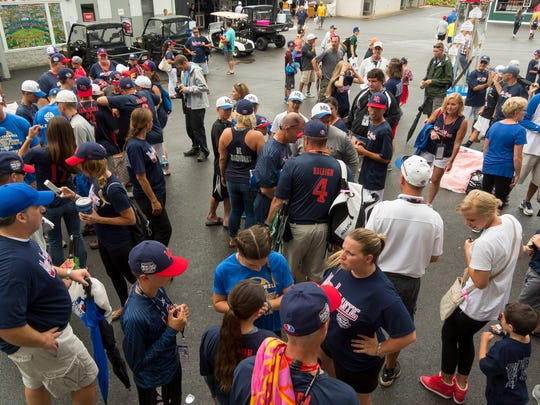 Maine-Endwell team members, family and supporters talk ouside Lamade Stadium Sunday afternoon after play was called off for the day following heavy rain at the Little League World Series in Williamsport.