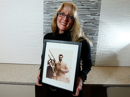 Judith Bosco of Wall Twp. holds a photo of her grandmother, Ada Lunardoni, posing with boxer Jack Dempsey as they were on their way to the 1936 Olympic in Berlin. Lunardoni was a member of the first women's gymnastics team to compete in the Olympics.  The team is the subject of  a new work by award-winning author Darrah Cloud called 'Turning.' Excerpts from the play will receive a staged reading January 31, by Centenary Stage Co. in Hackettstown. January 22, 2018. Neptune, NJ.