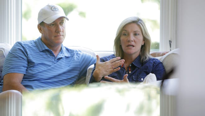 Jim Kelly, left, and his wife Jill during a 2010 interview at their home.