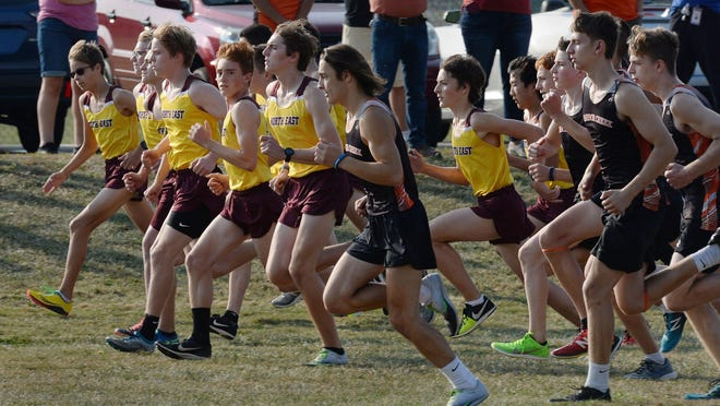 Varsity runners from North East High School, left, and Harbor Creek High School start a cross country race on Sept. 24, 2020, in North East.