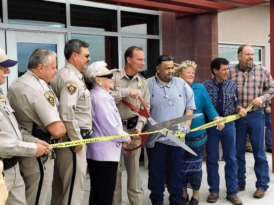 "Stevey Almanza — Headlight Photo   Luna County officials were on hand Thursday for the grand opening of the new Luna County Sheriff's Office at 2462 J Street SE in the Industrial Park. County officials held a ribbon cutting ceremony and the LCSO provided an open house for the public, along with light refreshments. Pictured from left are: Mike Eby, Richard Cowles, Kelly Gannaway, State Rep. Dona Irwin, Sheriff John Mooradian, Luna County Commissioners Joe ""Oleo"" Milo, Linda Smrkovsky and Javier Diaz, and Luna County Manager Charles ""Tink"" Jackson."