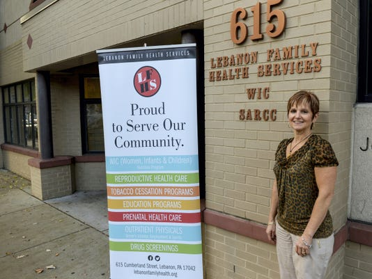Vicki DeLoatch, vice president of finance and marketing at Lebanon Family Health Services, poses for a photo outside of the building at 615 Cumberland St., Lebanon, on Thursday. The organization is starting to feel the pain of the Pennsylvania budget impasse.