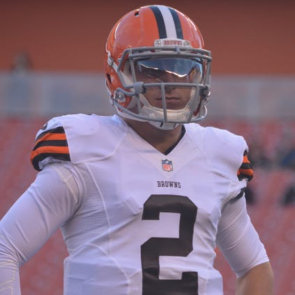 Browns quarterback Johnny Manziel relates to Ohio State's J.T. Barrett, who will start for the Buckeyes today.