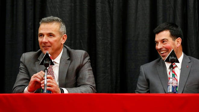 Urban Meyer, alongside soon-to-be Ohio State coach Ryan Day, addresses members of the media after announcing his intentions to retire following the Rose Bowl. Meyer has gone 82-9 in seven seasons leading the Buckeyes.