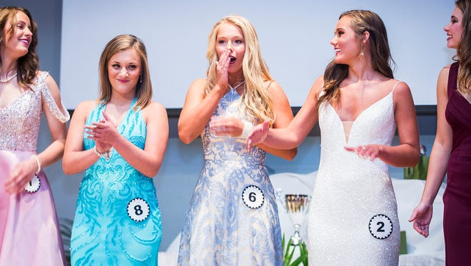 Cora Conatser reacts to winning the crown during the 2018 Delaware County Fair Queen Pageant at Delta High School Saturday evening.