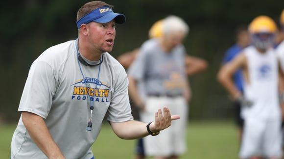 Eddie Eviston coaching at Newport Central Catholic in 2012.