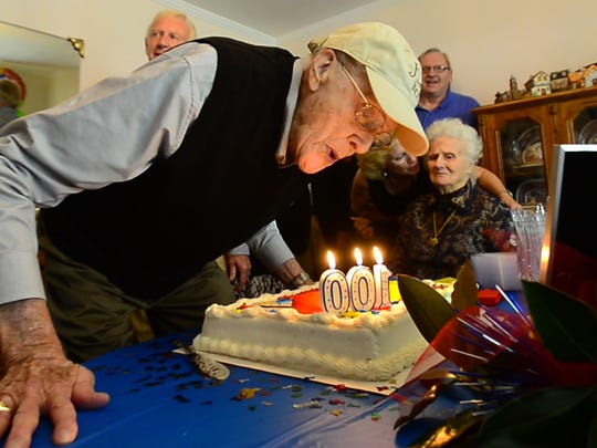 World War II veteran Henry Montgomery celebrates his 100th birthday surrounded by family and friends. He and his brother Homer Montgomery, 91, also a World War II veteran will be traveling together on the upcoming Upstate Honor Flight.