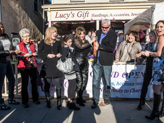 (L-R) Morristown Councilwoman Toshiba Foster of Morristown, Council President Rebecca Feldman, Manager Chonda Rosario of Belleville, store namesake Lucy, 10, daughter of mom Marisa Spagnoletti of Morristown, Mayor Tim Dougherty, Karen Carbonella, Director of Safe in Hunterdon, Ann Uzzardi of Roseland, Marisa's Executive Assistant, and Yvette Tosado of Morris Plains, Manager, at the Grand Opening and Chain Cutting of Lucy's Gift in Morristown, November 14, 2015.