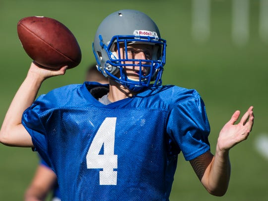 Cedar Crest sophomore Logan Horn turns to throw during a preseason practice, now firmly entrenched as the team's starting quarterback.