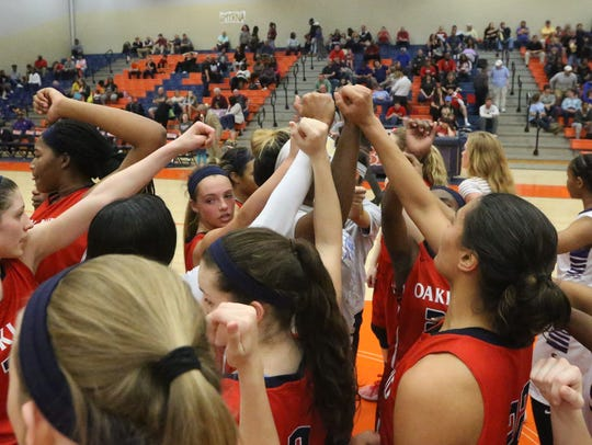Oakland's girls huddle during the District 7-AAA consolation