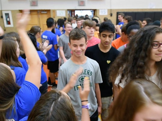 Ninth-graders arriving for the first day of class are greeted by upperclassmen during a group orientation program for incoming freshmen at York Suburban High School. The rest of the high school student body returns Thursday.