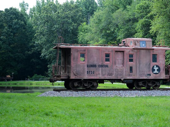 A 1940 Illinois Central caboose now sits on the property