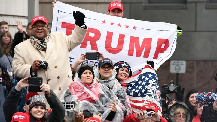 People along the parade route show their support for President Donald J. Trump.
