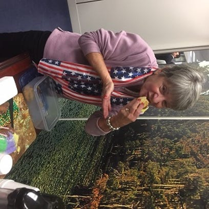 Carolyn Smith tries out the King Cake at Sen. Bill
