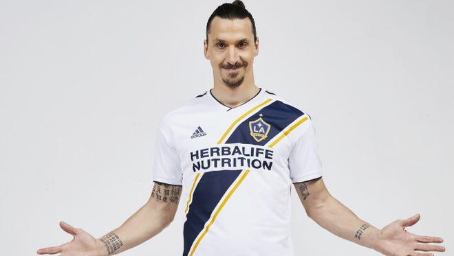 Zlatan Ibrahimovic poses in the uniform of his new club, the L.A. Galaxy.