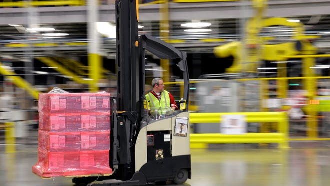 A forklift operator moves a pallet of goods at an Amazon.com fulfillment center in DuPont, Wash.