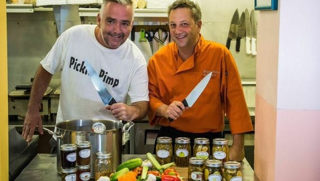 Benjamin Neff and Tony Maynard working in the kitchen of The Pickle Baron of Key West.