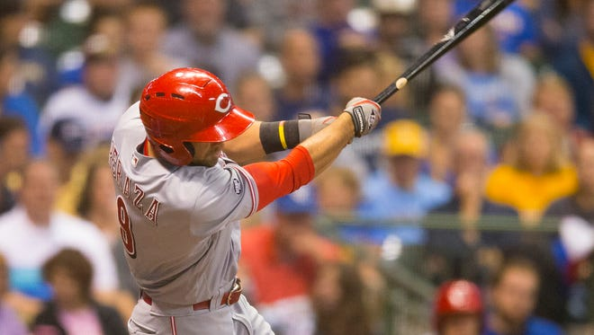 Cincinnati Reds shortstop Jose Peraza (9) hits a home run during the fifth inning against the Milwaukee Brewers at Miller Park.
