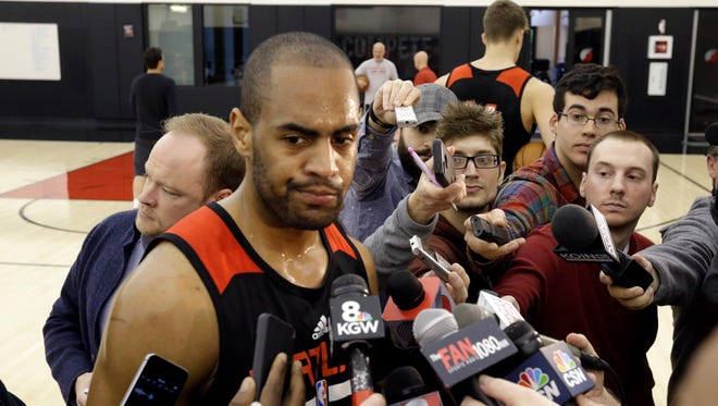 Portland Trail Blazers guard Arron Afflalo talks with reporters after NBA basketball practice in Portland, Ore., Friday, April 24, 2015. The Memphis Grizzlies lead the Trail Blazers 2-0 in their first round series heading into Saturday's Game 3 in Portland. Afflalo will play in Saturday's game after sitting out the first two games because of a right shoulder injury.